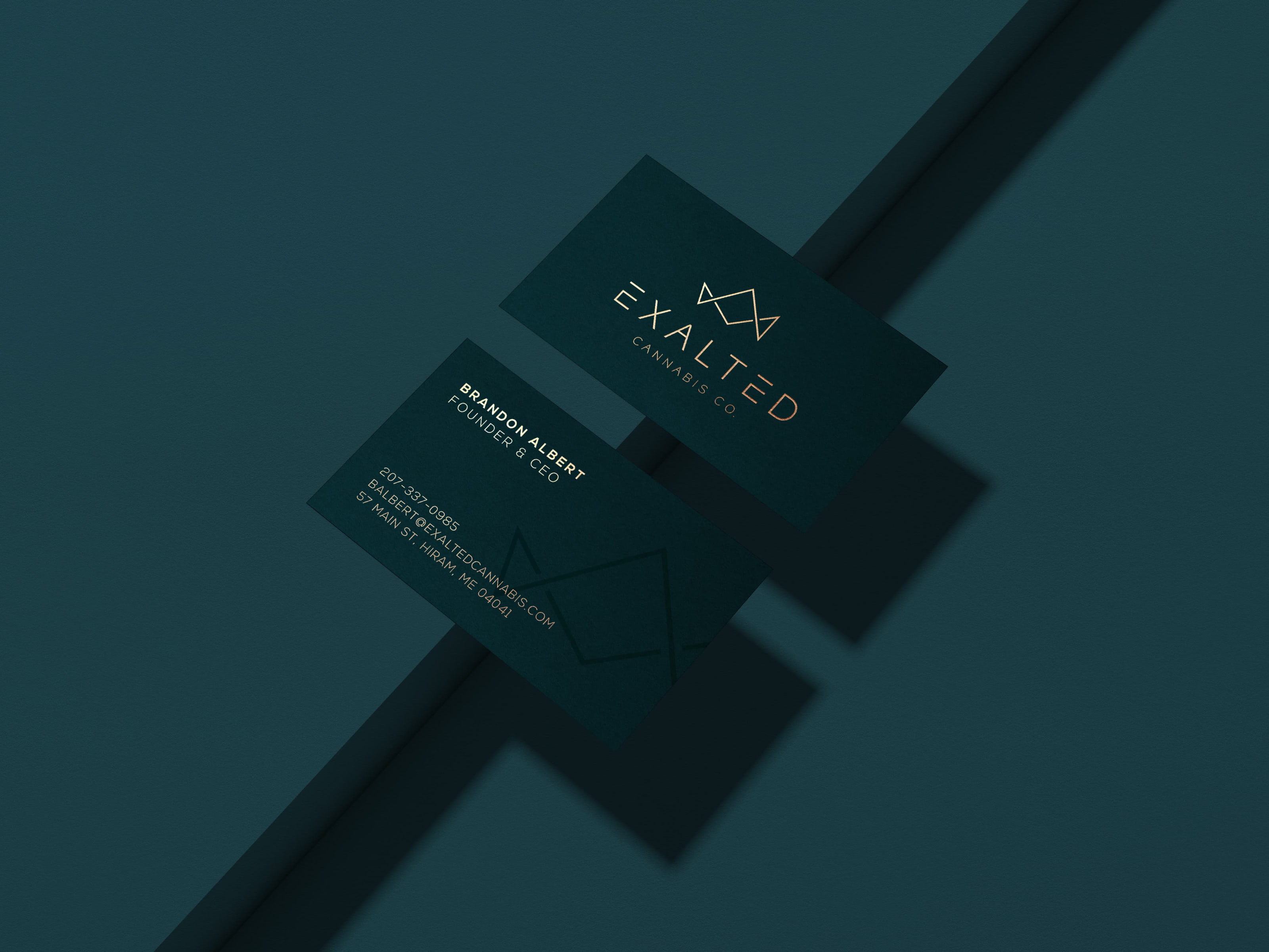 Exalted business card 3D mockup with gold foil accents on a dark background
