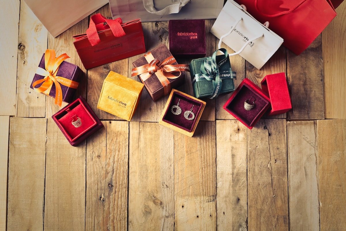 Wrapped jewelry boxes on a wooden surface