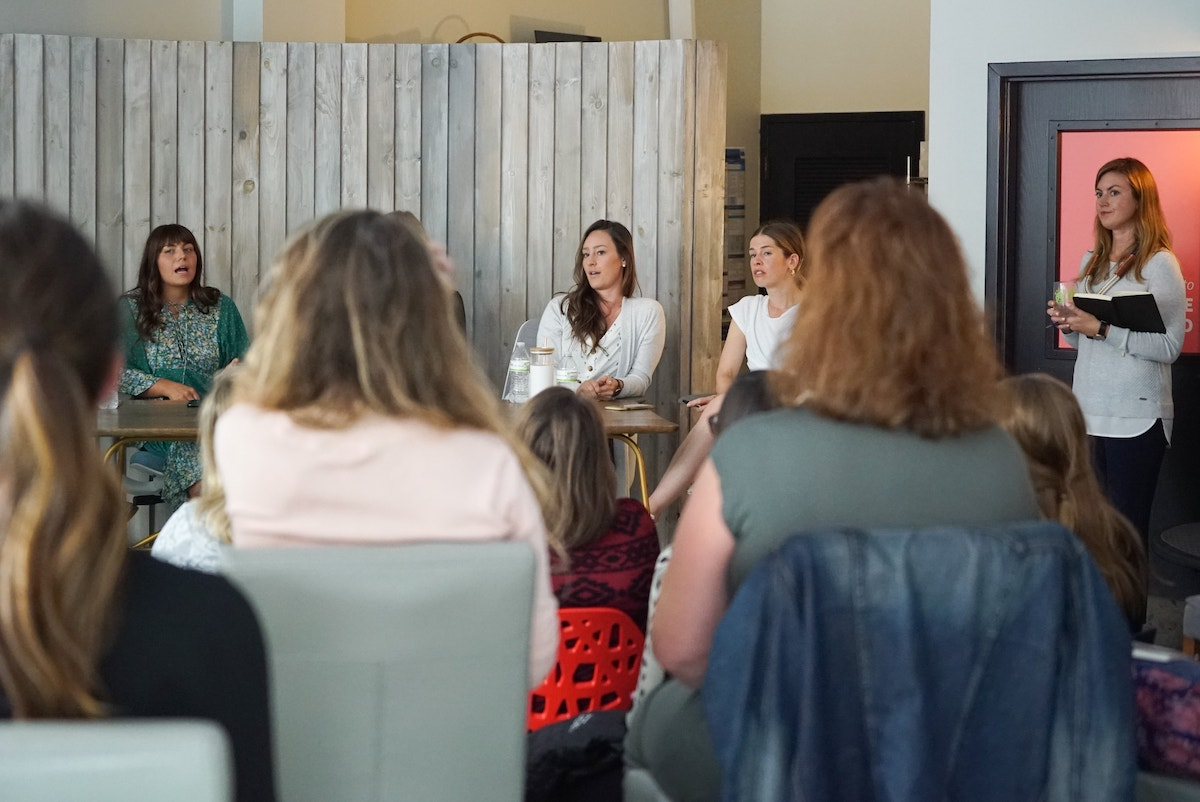 A crowd of people sit in front of a panel of Instagram Influencers at an iBec Creative event.