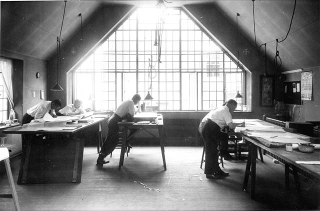 old black and white photo of men working at drafting tables