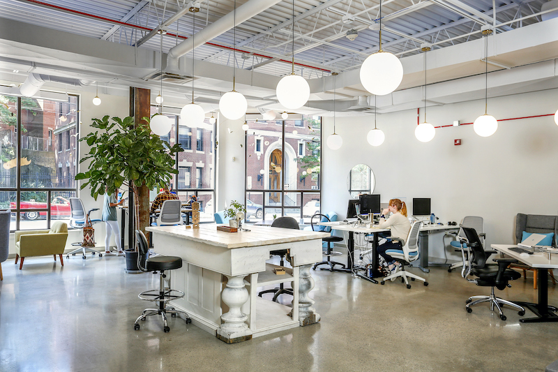 iBec office with an open concept, industrial style work space.