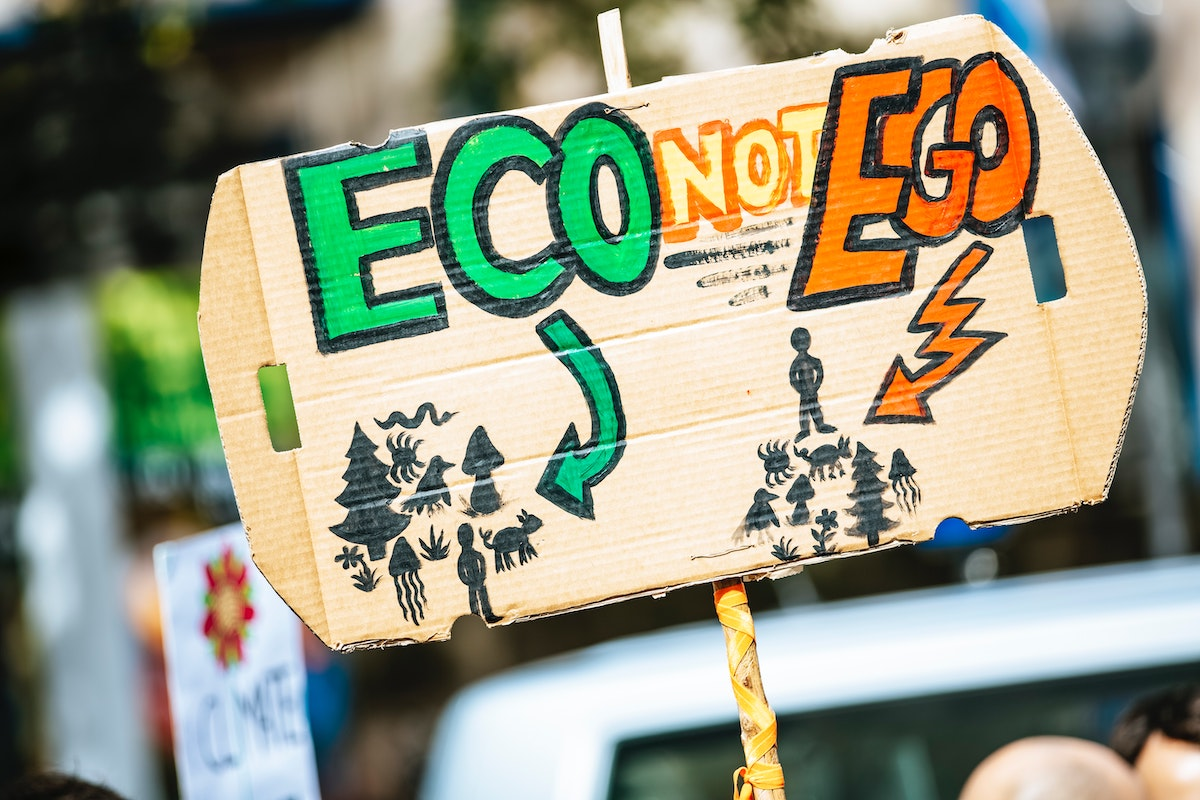 Climate change cardboard protest sign says