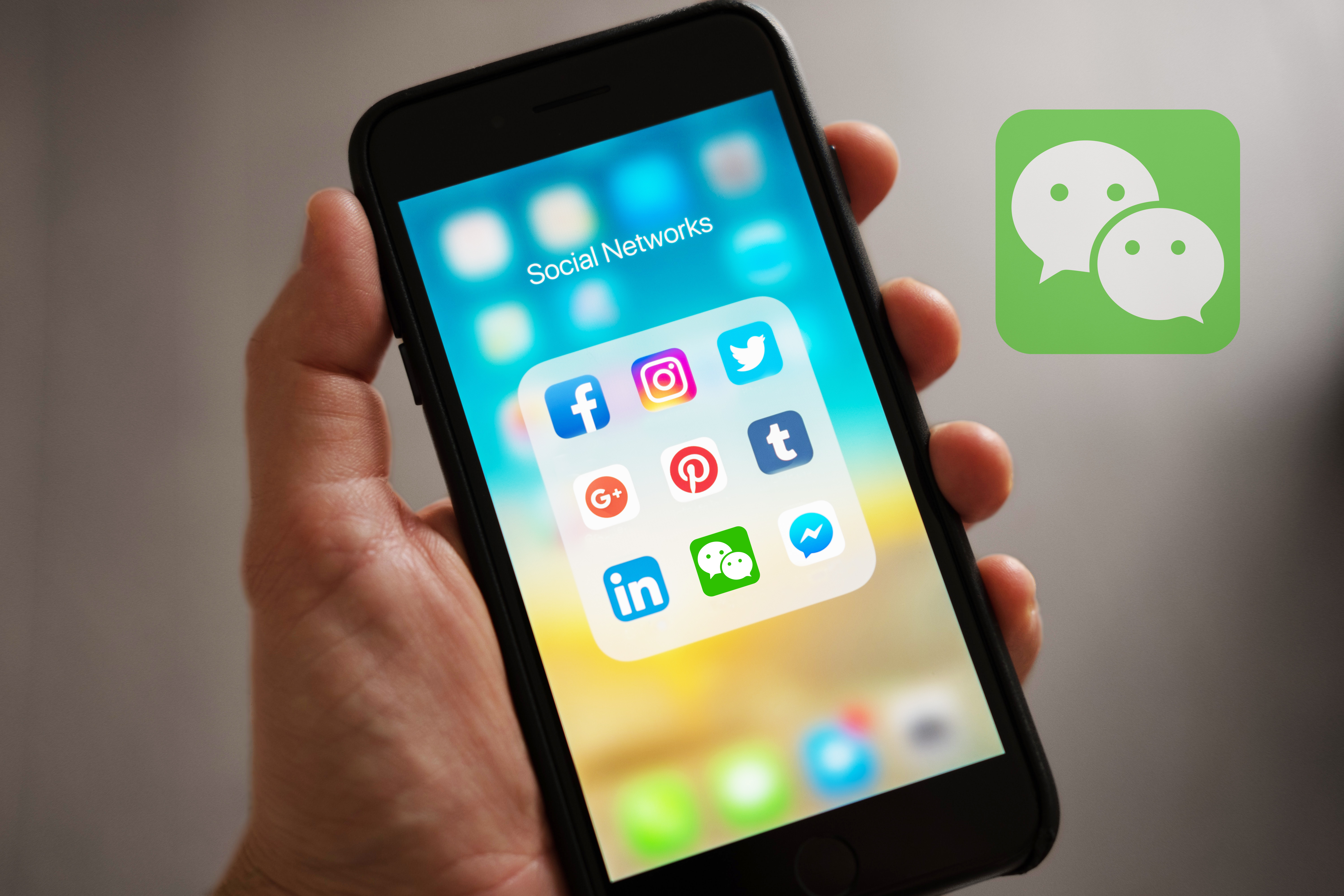 WeChat app in a folder with other social network apps on an iPhone
