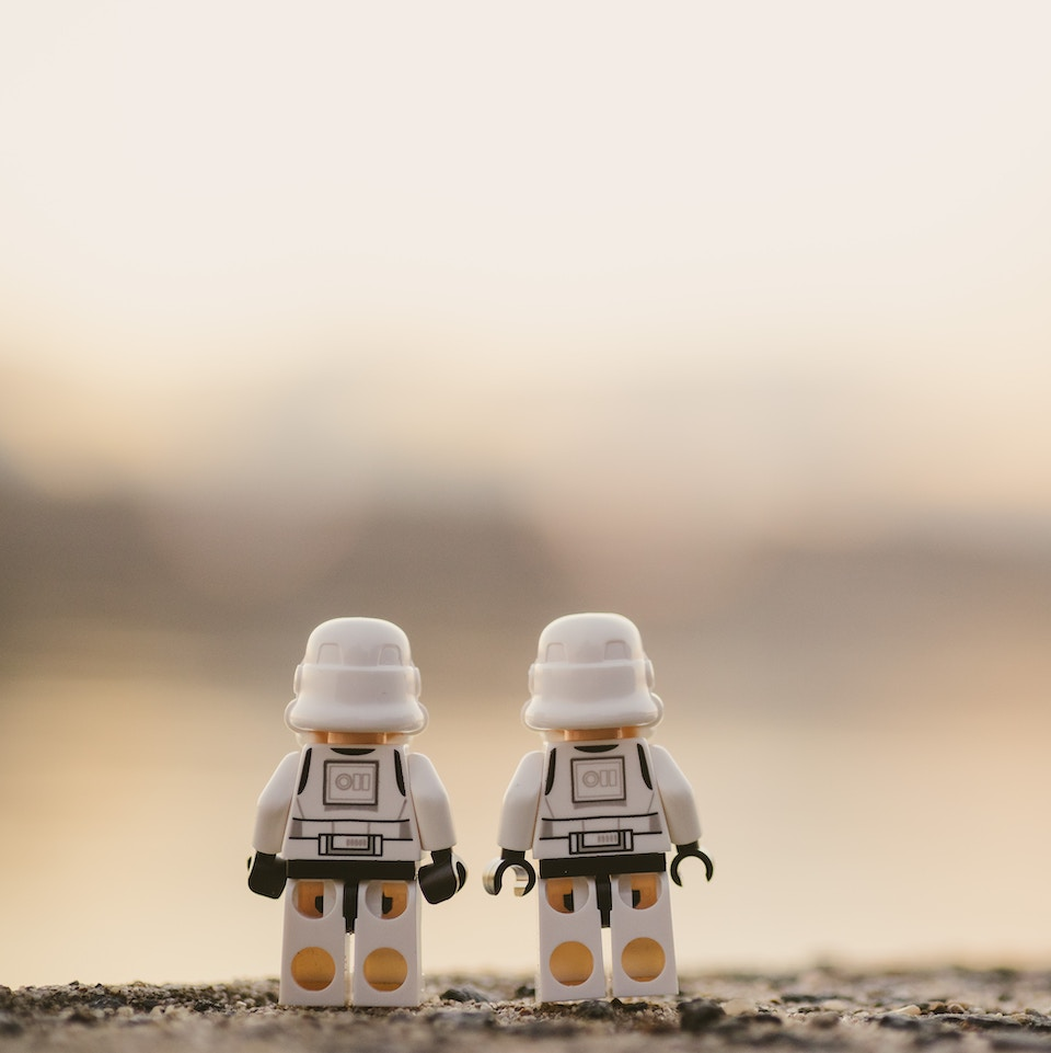 Two stormtrooper Legos looking off into the distance