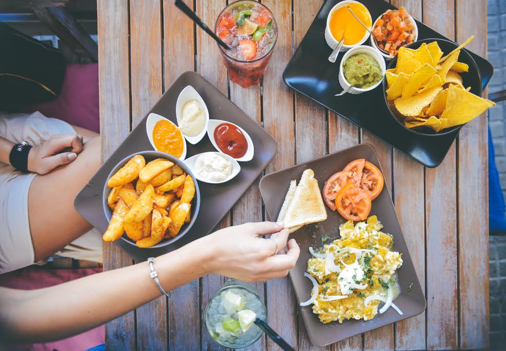 Colorful food spread on a wooden table