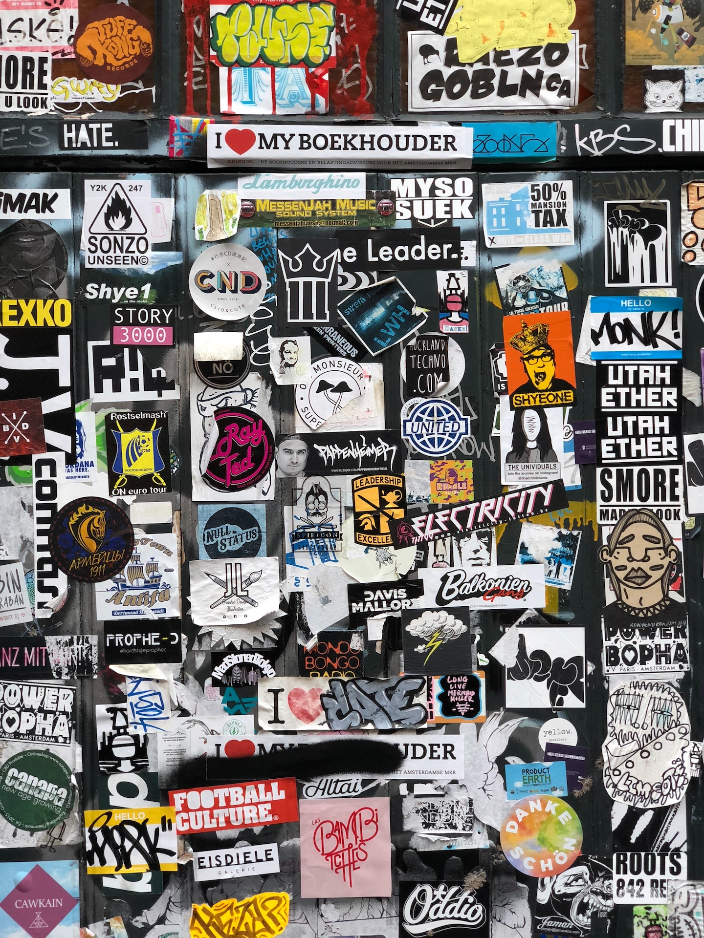 assortment of stickers covering a wall